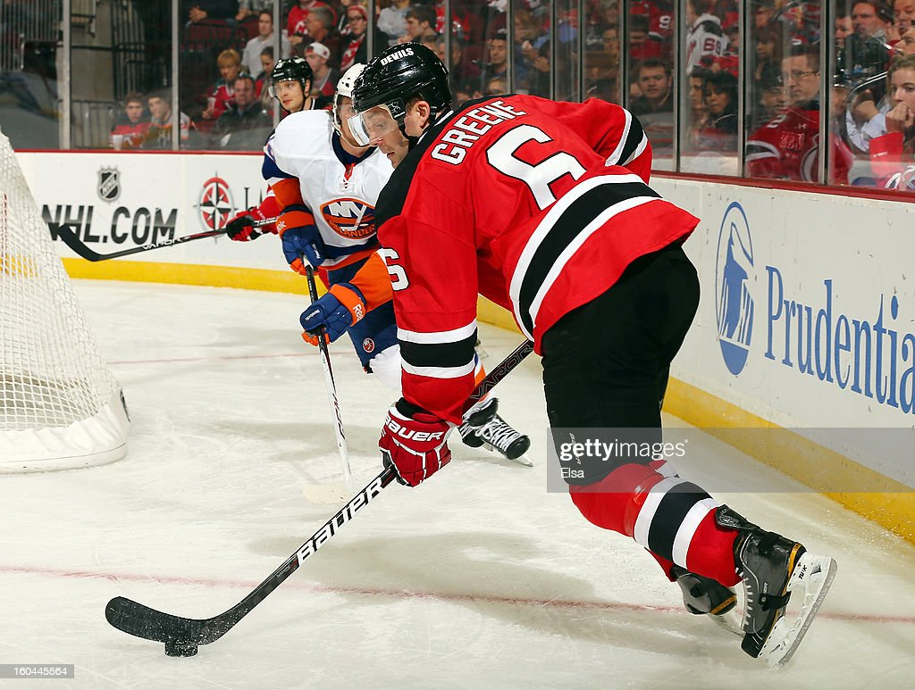 Andy Greene #6 of the New Jersey Devils takes the puck in the third period against the New York Islanders at the Prudential Center on January 31, 2013 in Newark, New Jersey.The New York Islanders defeated the New Jersey Devils 5-4 in overtime.