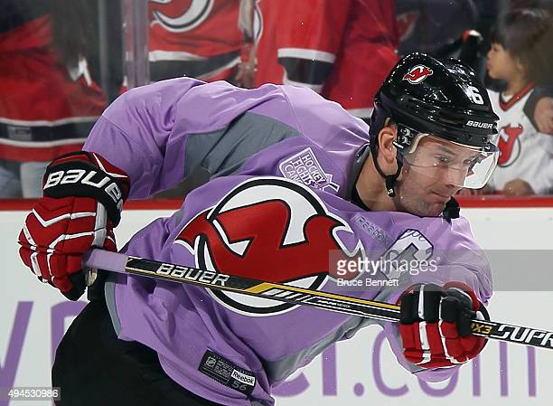 Andy Greene of the New Jersey Devils takes the shot during warmups while wearing a Hockey Fights Cancer jersey prior to the game against the Columbus...