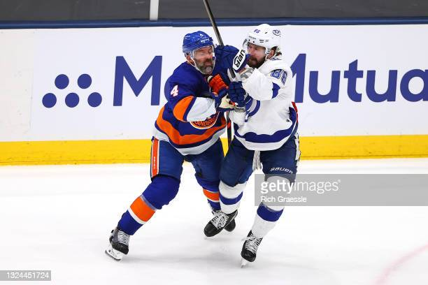 Andy Greene of the New York Islanders and Nikita Kucherov of the Tampa Bay Lightning battle for position during the first period in Game Four of the...