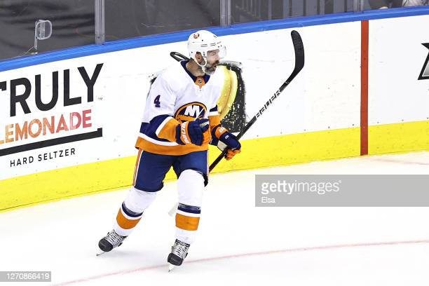 Andy Greene of the New York Islanders celebrates after scoring a goal against the Philadelphia Flyers during the first period in Game Seven of the...