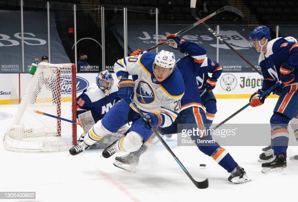 Andy Greene of the New York Islanders defends against Cody Eakin of the Buffalo Sabres during the first period at the Nassau Coliseum on March 04,...