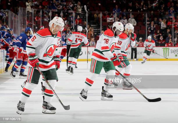 Andy GreenePK Subban and Travis Zajac of the New Jersey Devils skate off the ice after the loss to the New York Rangers at Prudential Center on...