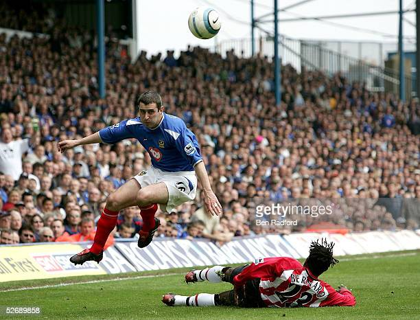 Andy Griffin of Portsmouth hurdles a tackle from Olivier Bernard of Southampton during the Barclays Premiership match between Portsmouth and...