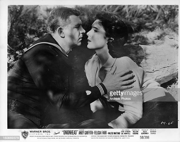 Andy Griffith and Felicia Farr in romantic embrace in a scene from the film 'Onionhead' 1958