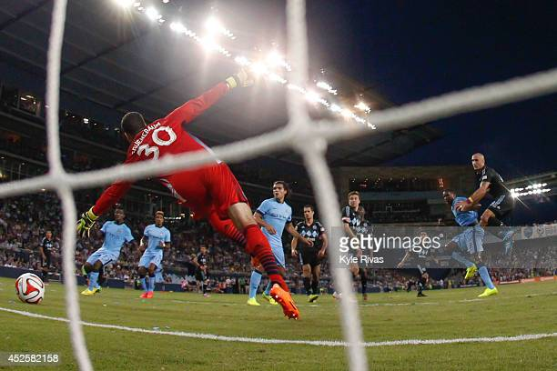 Andy Gruenebaum of Sporting KC fails to stop the shot on goal by Dedrick Boyata of Manchester City late in the first half on July 23rd at Sporting...