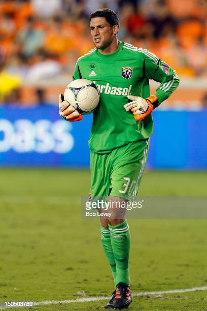 Andy Gruenebaum of the Columbus Crew comes up limping after a save against the Houston Dynamo at BBVA Compass Stadium on August 19 2012 in Houston...