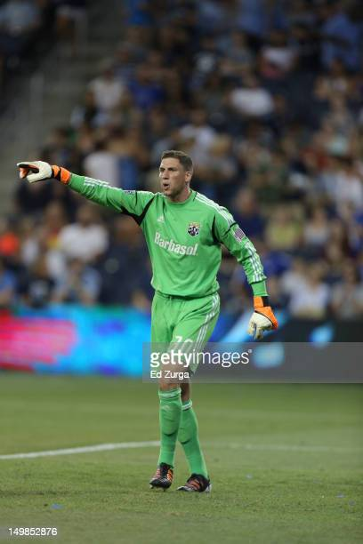 Andy Gruenebaum of the Columbus Crew directs the defense during a Sporting Kansas City corner kick at Livestrong Sporting Park on July 28 2012 in...