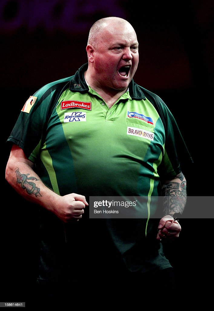 Andy Hamilton of England celebrates during his second round match on day eight of the 2013 Ladbrokes.com World Darts Championship at the Alexandra Palace on December 21, 2012 in London, England.