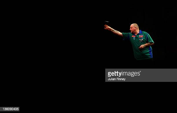 Andy Hamilton of England in action in his match against Antonio Alcinas of Spain during day five of the 2012 Ladbrokescom World Darts Championship at...