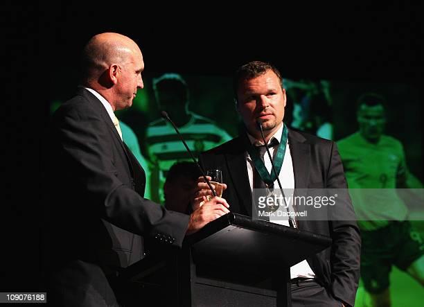 Andy Harper interviews former Socceroo Mark Viduka after the presentation of the Alex Tobin Medal during the Alex Tobin Medal Dinner at Crown...