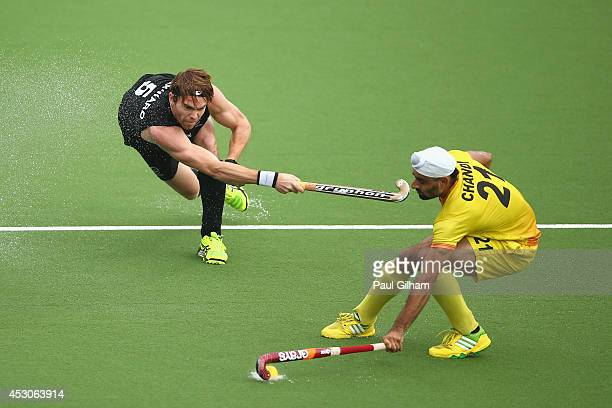 Andy Hayward of New Zealand battles for the ball with Gurwinder Chandi of India during the Men's SemiFinal match between New Zealand and India at...