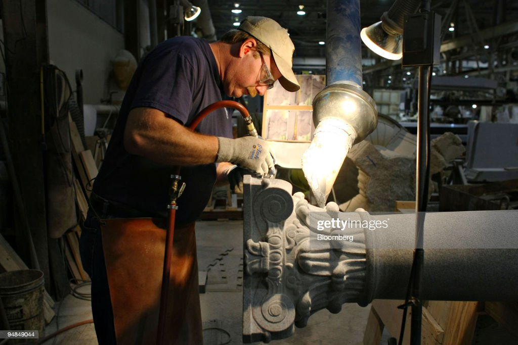 Andy Hebert works on a granite column in a Rock of Ages Corp : News Photo
