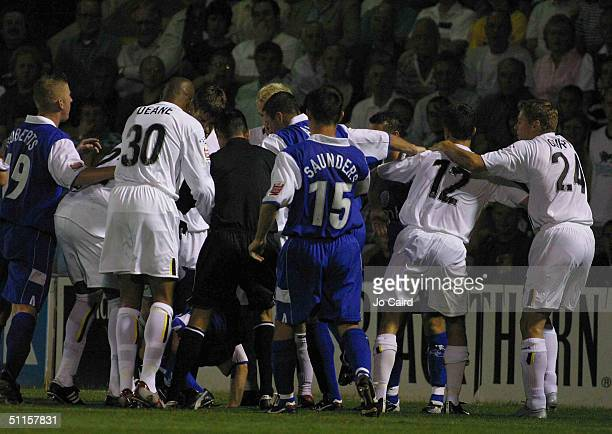 Andy Hessenthaler of Gillingham is at the bottom of a scuffle started with Danny Pugh of Leeds during the Coca-Cola Championship match between...