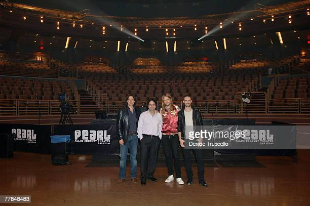 LAS VEGAS NOVEMBER 10 Andy Hewitt Palms Casino owner George Maloof guitarist James Valentine of Maroon 5 and singer Adam Levine of Maroon 5 pose for...