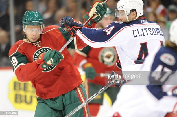Andy Hilbert of the Minnesota Wild fights off Grant Clitsome of the Columbus Blue Jackets during the first period of a preseason game on September 18...