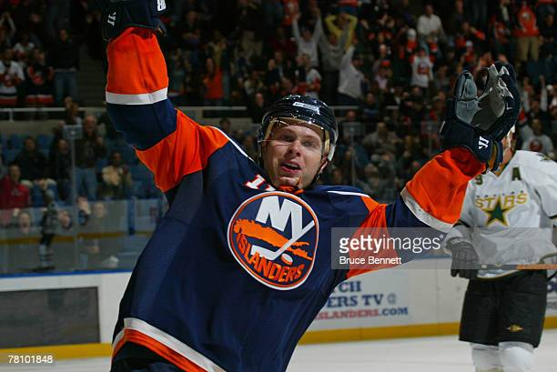 Andy Hilbert of the New York Islanders celebrates a second period goal by teammate Richard Park against the Dallas Stars on November 26 2007 at the...