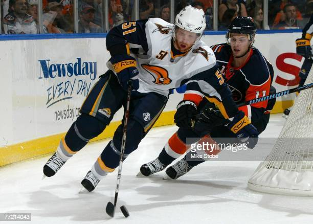 Andy Hilbert of the New York Islanders chases down Brian Campbell of the Buffalo Sabres around the net on October 6 2007 at Nassau Coliseum in...