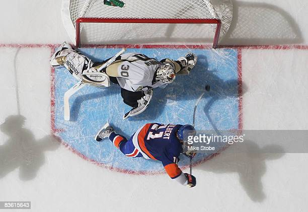 Andy Hilbert of the New York Islanders fires the puck past goaltender Dany Sabourin of the Pittsburgh Penguins for a secondperiod goal on November 8...