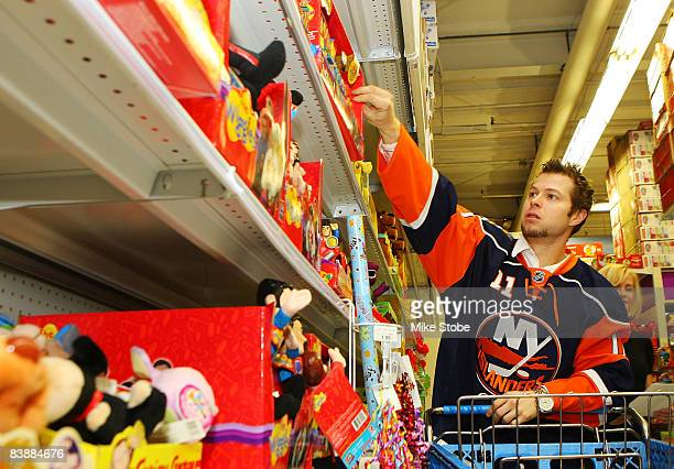 Andy Hilbert of the New York Islanders goes shopping for children in the hospital during the holiday season on December 2 2008 at ToysRUs in Carle...