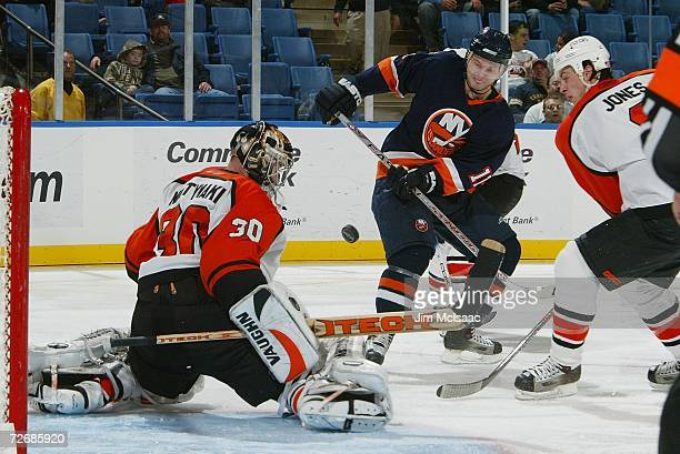 Andy Hilbert of the New York Islanders has his shot stopped by Antero Niittymaki of the Philadelphia Flyers November 30 2006 at Nassau Coliseum in...