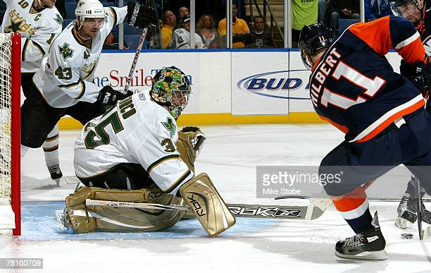 Andy Hilbert of the New York Islanders is denied by Marty Turco of the Dallas Stars at Nassau Coliseum November 26 2007 in Uniondale New York