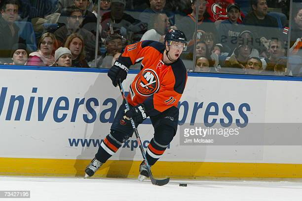 Andy Hilbert of the New York Islanders looks to play the puck against the New Jersey Devils on February 17 2007 at Nassau Coliseum in Uniondale New...
