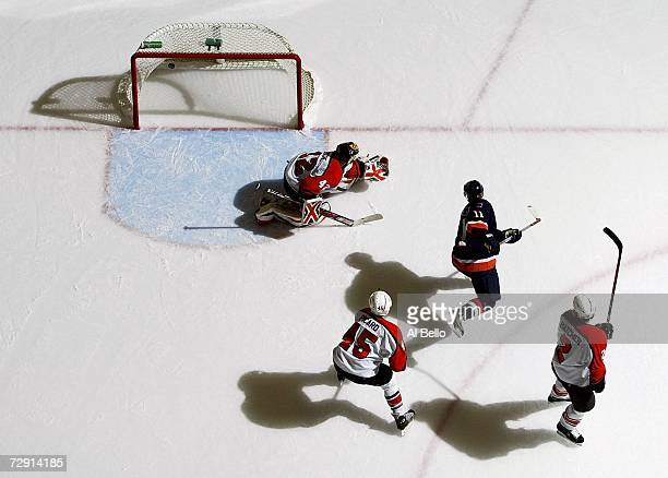 Andy Hilbert of the New York Islanders scores a goal against Robert Esche of the Philadelphia Flyers during their game at the Nassau Coliseum January...