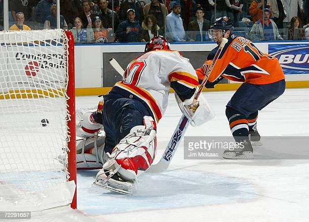 Andy Hilbert of the New York Islanders scores the game winning goal during a shootout against Ed Belfour of the Florida Panthers during their game on...