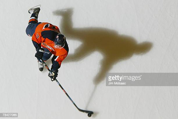 Andy Hilbert of the New York Islanders shoots a puck during warmups before the game against the New Jersey Devils on February 17 2007 at Nassau...