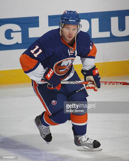 Andy Hilbert of the New York Islanders skates against the New Jersey Devils at the Nassau Veterans Memorial Coliseum on October 2 2010 in Uniondale...