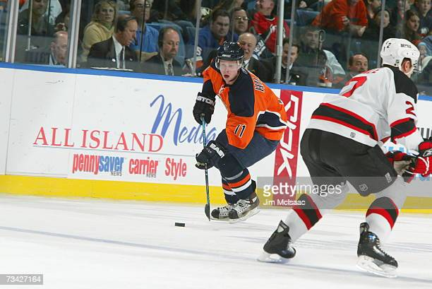 Andy Hilbert of the New York Islanders skates with the puck against the New Jersey Devils on February 17 2007 at Nassau Coliseum in Uniondale New...
