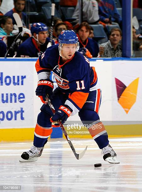 Andy Hilbert of the New York Islanders skating with the puck during a game against the New Jersey Devils at Nassau Veterans Memorial Coliseum on...