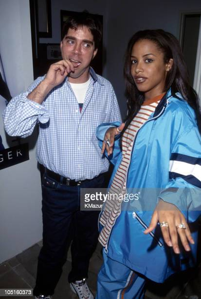 Andy Hilfiger and Aaliyah during Tommy Hilfiger Fall 2000 Fashion Show Backstage at Macy's in New York City New York United States
