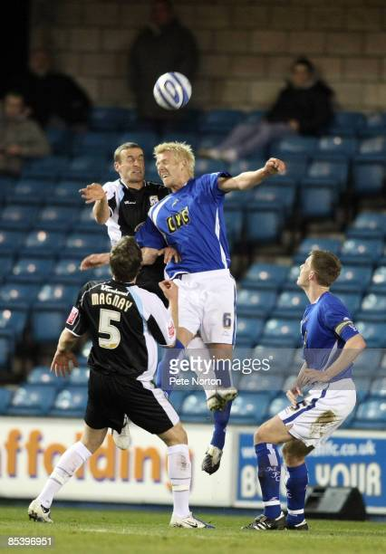 Andy Holt of Northampton Town challenges for the ball with Zak Whitbread of Millwall during the Coca Cola League One Match between Millwall and...