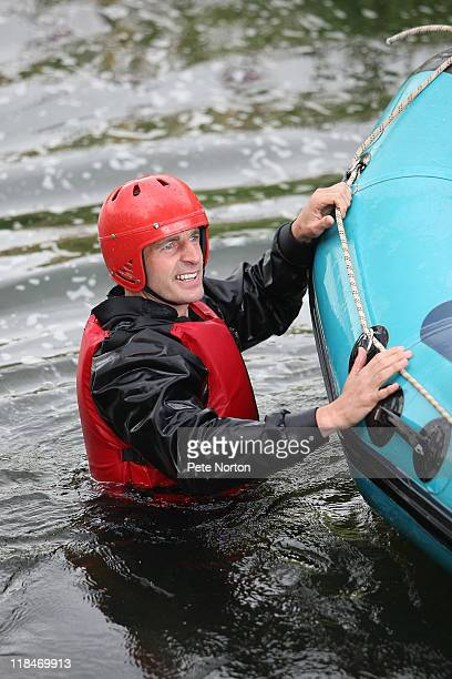 Andy Holt of Northampton Town holds onto the side of his raft during a training session at Nene Whitewater Centre on July 7, 2011 in Northampton,...