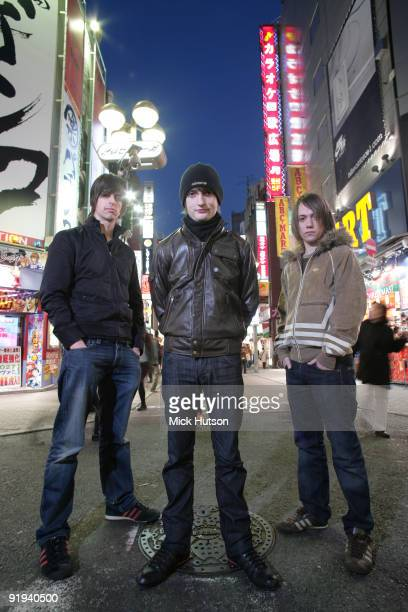 Andy Hopkins Tom Clarke and Liam Watts of The Enemy pose for a group shot in the street in Tokyo Japan on December 9th 2007