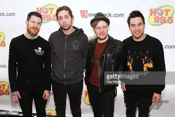 R Andy Hurley Joe Trohman Patrick Stump and Pete Wentz of Fall Out Boy on the red carpet at the Hot 995's Jingle Ball 2013 at Verizon Center on...