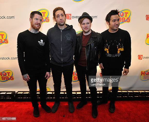 Andy Hurley Joe Trohman Patrick Sump and Pete Wentz of Fall Out Boy attend Hot 995's Jingle Ball 2013 presented by Overstockcom at Verizon Center on...
