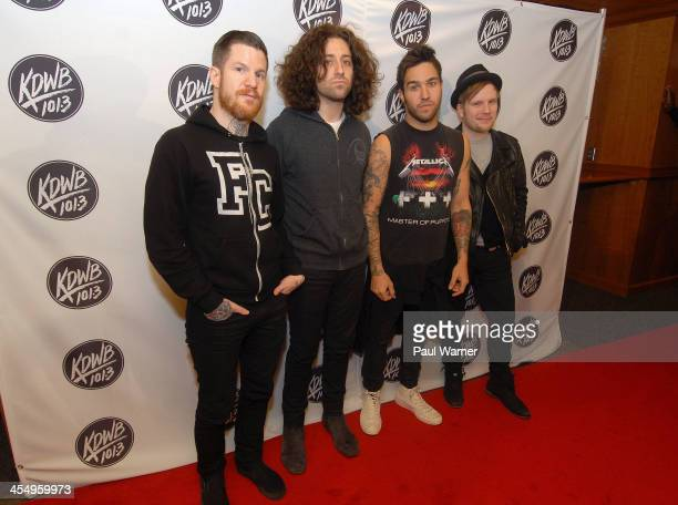 Andy Hurley Joe Trohman Pete Wentz and Patrick Stump of Fall Out Boy pose at the 1013 KDWB's Jingle Ball 2013 at Xcel Energy Center on December 10...