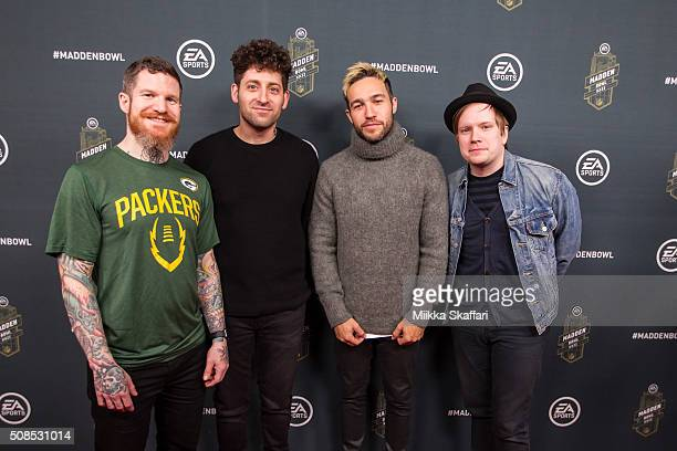 Andy Hurley Joe Trohman Pete Wentz and Patrick Stump of Fall Out Boy arrive at Madden Bowl XXII at Nob Hill Masonic Center on February 4 2016 in San...