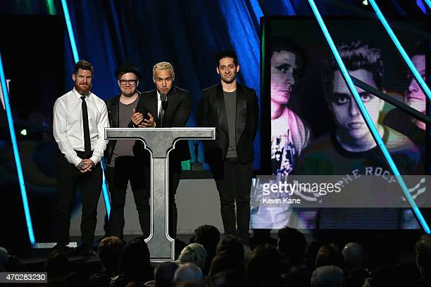 Andy Hurley Patrick Stump Pete Wentz and Joe Trohman of Fall Out Boy induct Green Day onstage during the 30th Annual Rock And Roll Hall Of Fame...