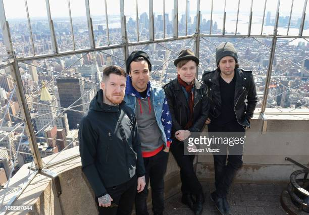 Andy Hurley Pete Wentz Patrick Stump and Joe Trohman of 'Fall Out Boy' visit The Empire State Building on April 15 2013 in New York City