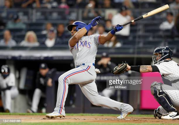 Andy Ibanez of the Texas Rangers singles during the first inning against the New York Yankees at Yankee Stadium on September 20, 2021 in New York...