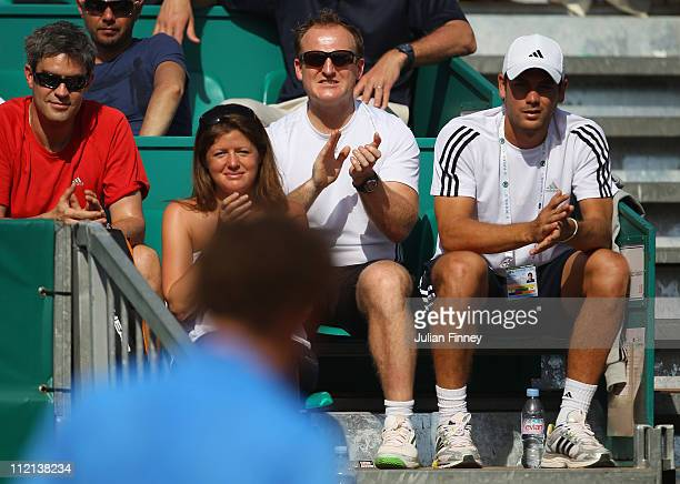 Andy Ireland agent Matt Little and Daniel Vallverdu watch Andy Murray of Great Britain play Radek Stepanek of Czech Republic during Day Four of the...