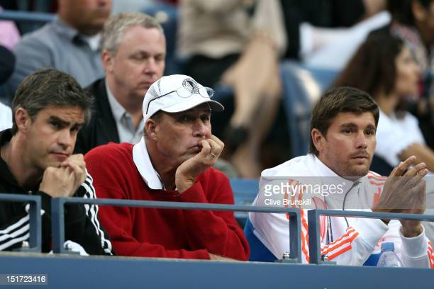 Andy Ireland coach Ivan Lendl and Daniel Vallverdu watch Andy Murray of Great Britain during his men's singles final match against Novak Djokovic of...