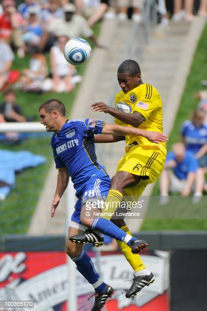 Andy Iro of the Columbus Crew heads the ball as Graham Zusi of the Kansas City Wizards defends on May 23 2010 at Community America Park in Kansas...