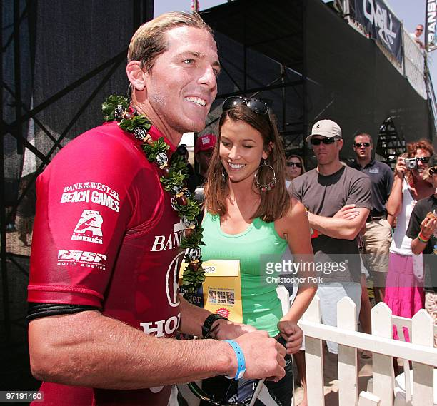 Andy Irons celebrates with girlfirend Lyndie Dupuis after winning the Men's finals of the US Open of Surfing in Huntington Beach Calif Sunday July 31...