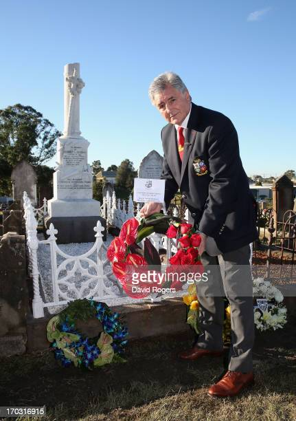 Andy Irvine tour manager of the British Irish Lions lays a wreath during a visit to the grave of 1888 Lions Captain Robert Sneddon at the Campbells...