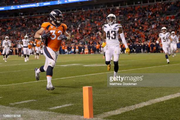 Andy Janovich of the Denver Broncos carries the ball for a touchdown against the Los Angeles Chargers at Broncos Stadium at Mile High on December 30...