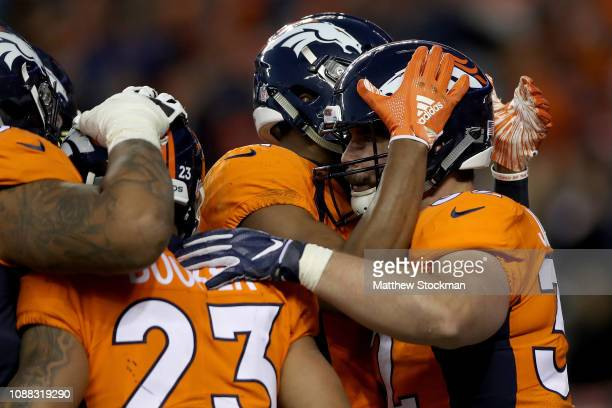 Andy Janovich of the Denver Broncos is congratulated by his teammates after scoring a touchdown against the Los Angeles Chargers at Broncos Stadium...